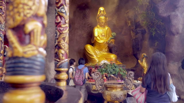 praying at a temple in taipei, taiwan - guanyin bodhisattva stock videos & royalty-free footage
