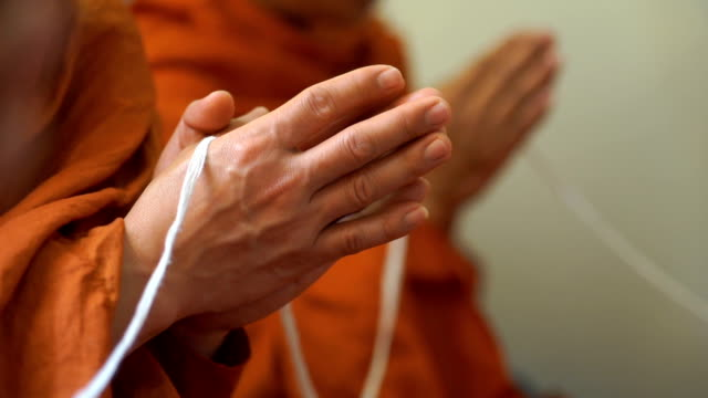 praying monk hand - buddhism stock videos & royalty-free footage
