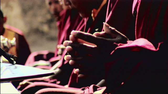 cu tu praying monks / tsarang, mustang, nepal - monk stock videos and b-roll footage