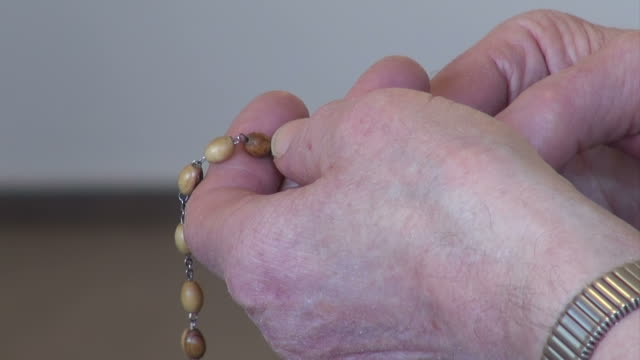praying rosary - nun stock videos and b-roll footage