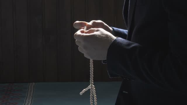 praying with prayer beads beads - pilgrimage stock videos & royalty-free footage