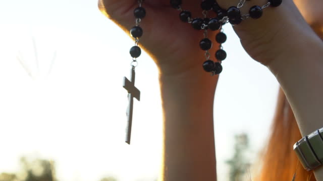 praying with rosary cross - praying stock videos & royalty-free footage