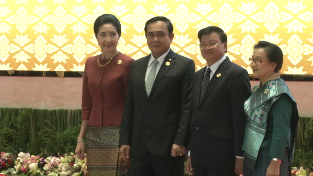 prayut chan-o-cha and wife are greeted by the laos prime minister thongloun sisoulith and wife at the association of southeast asian nations summit... - association of southeast asian nations stock videos & royalty-free footage