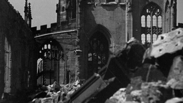 1945 MONTAGE Pre WWII city skyline, factory smokestack billowing, and cathedral and other buildings in rubble after 1940 German bombing / Coventry, West Midlands, England