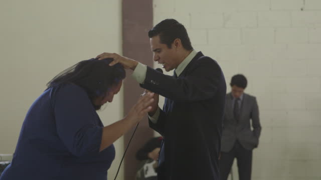 preacher baptizes woman in tijuana, montage - preacher stock videos and b-roll footage
