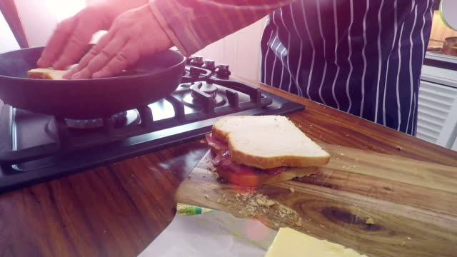 preaparing and roasting bacon sandwich - making a sandwich stock videos and b-roll footage