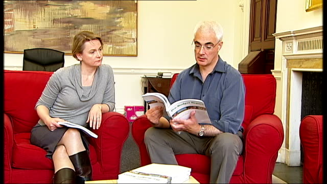 alistair darling and team with pbr england london photography *** alistair darling mp / darling leafing through prebudget report as sitting on sofa... - alistair darling stock videos & royalty-free footage