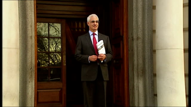 london hm treasury ext alistair darling mp out of treasury as poses for press photocall on steps holding copy of prebudget report then joined by... - alistair darling stock videos & royalty-free footage
