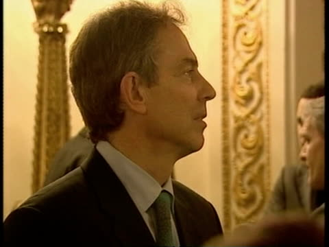 more borrowing downing street number 10 people attending reception for sports stars blair blair talking with west ham united footballer trevor... - sinclair institute stock videos and b-roll footage