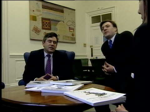 more borrowing; itn england: london: int chancellor gordon brown mp sitting with treasury chief secretary andrew smith mp and treasury team cms brown... - gordon brown stock-videos und b-roll-filmmaterial