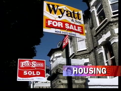 more borrowing itn cs 'for sale' sign 'sold' and 'for sale' sign outside houses cs sign '2nd floor flat' int estate agent showing couple kitchen of... - borrowing stock videos & royalty-free footage