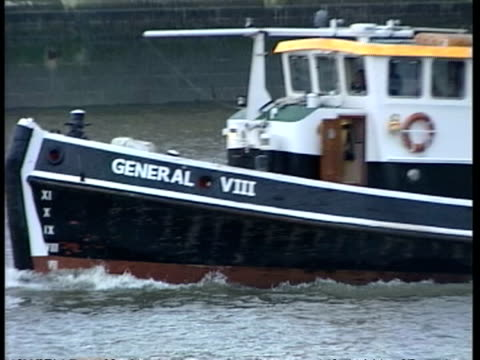 more borrowing westminster ext boat along river thames pull out past palace of westminster - borrowing stock videos & royalty-free footage