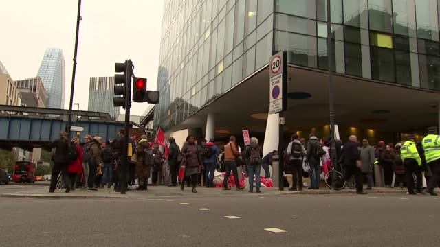 Precarious workers march as Uber begins appeal against driver's rights to minimum wage ENGLAND London Southwark EXT General views of Uber protest...