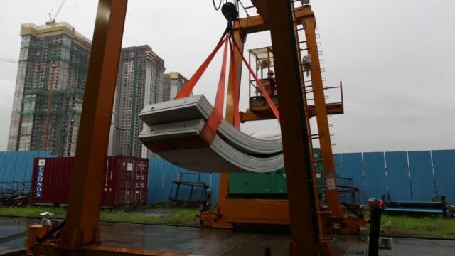 Precast concrete tunnel segments are maneuvered by crane at the Mumbai Metro Rail Corp casting yard in Mumbai India on Monday Aug 28 Precast concrete...