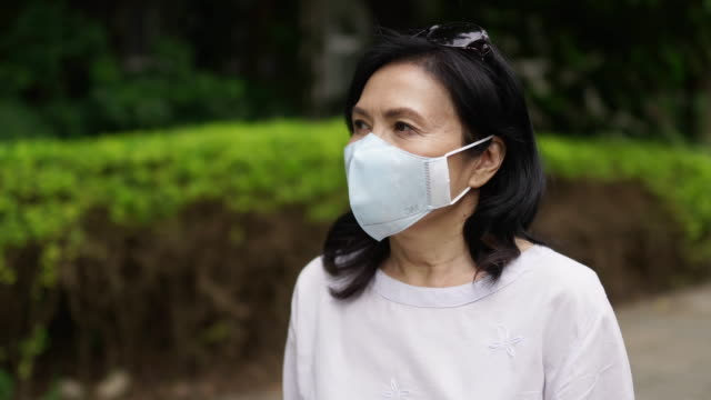precaution increased with ages - surgical mask stock videos & royalty-free footage