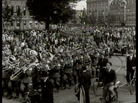 preceded by a military band german soldiers march through a street of the hague - the hague stock videos and b-roll footage