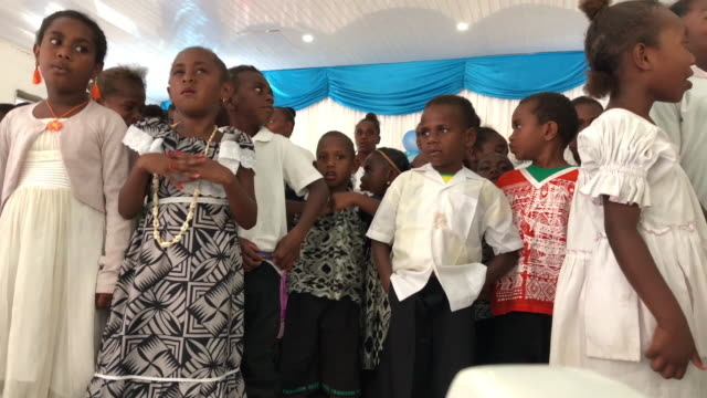 vídeos de stock e filmes b-roll de a prechirstmas celebration is held at a church on december 01 2019 in ifira vanuatu 25 percent of vanuatu's 276000 citizens lost their homes in 2015... - ilhas do pacífico