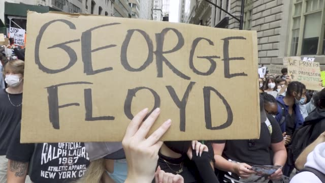 predominantly teenage and college age crowd of demonstrators rallied at foley square and marched throughout downtown manhattan in solidarity with the... - new age stock-videos und b-roll-filmmaterial