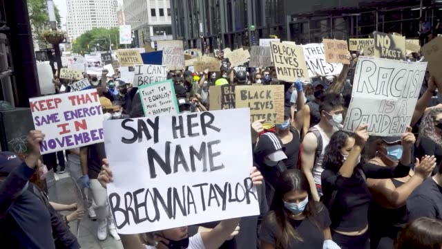 predominantly teenage and college age crowd of demonstrators rallied at foley square and marched throughout downtown manhattan in solidarity with the... - downtown stock videos & royalty-free footage
