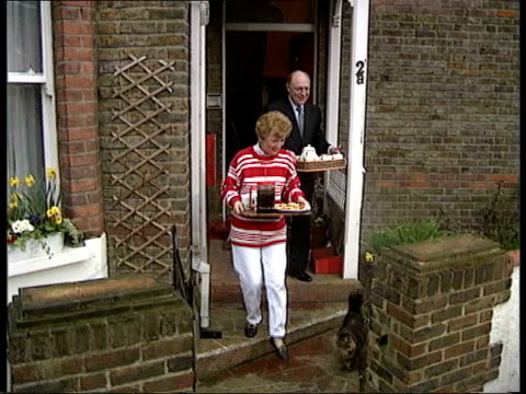 stockvideo's en b-roll-footage met preelection propoganda file / tx neil kinnock and wife glenys kinnock out of house with coffee and biscuits for press duirng election campaign - neil kinnock