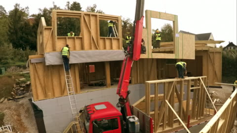 time-lapse prefab wooden home being built - wood material stock videos & royalty-free footage