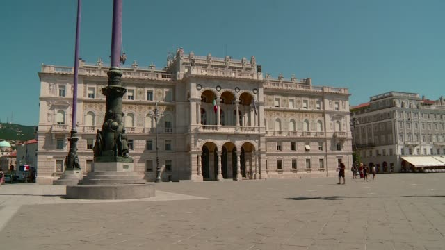 prefecture's palace in unità d'italia square triest there are some people walking in a summer day - number 4 stock videos & royalty-free footage