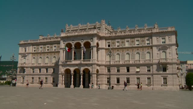 prefecture's palace in unità d'italia square triest with pedestrian - number 4 stock videos & royalty-free footage