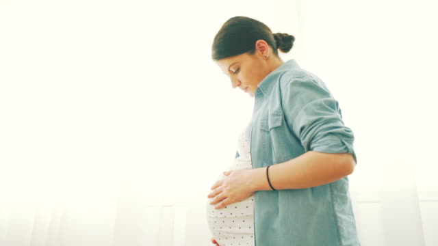 pregnancy is a miracle. - stroking stock videos & royalty-free footage