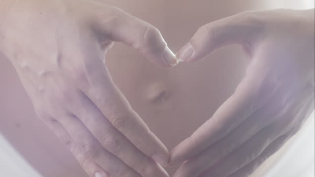 Pregnancy - Woman Belly With Heart Shape Hands
