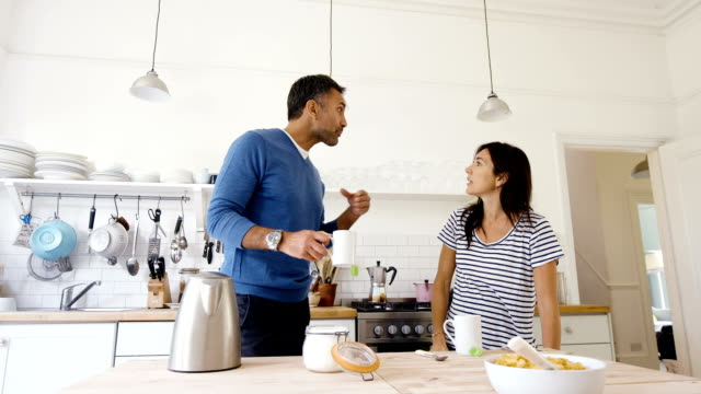 pregnant couple having an argument in kitchen - husband stock videos & royalty-free footage