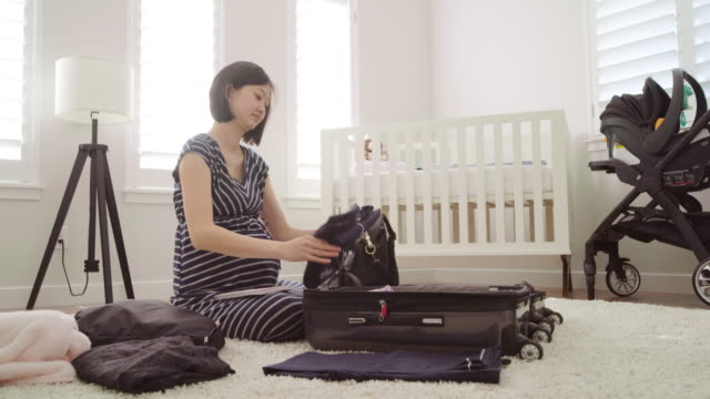 pregnant japanese woman in a nursery - nappy bag stock videos & royalty-free footage