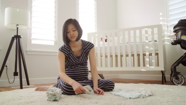 pregnant japanese woman in a nursery - nursery bedroom stock videos & royalty-free footage