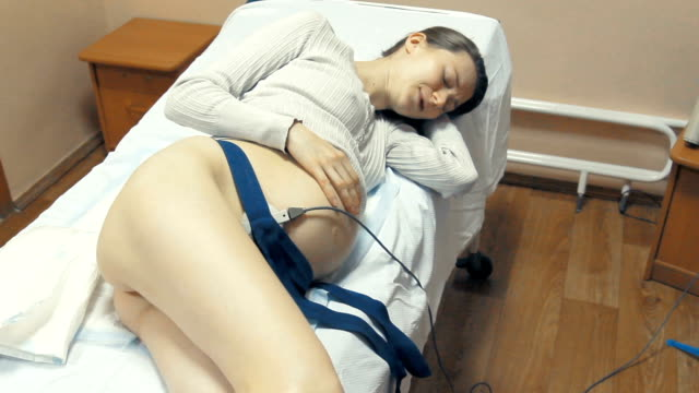 Pregnant patient lying in hospital bed