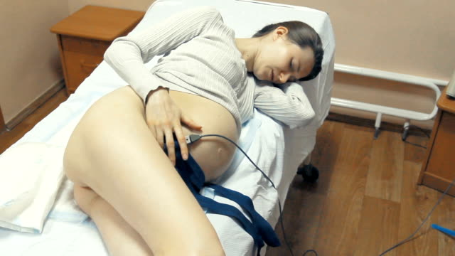 pregnant patient lying in hospital bed - childbirth stock videos and b-roll footage