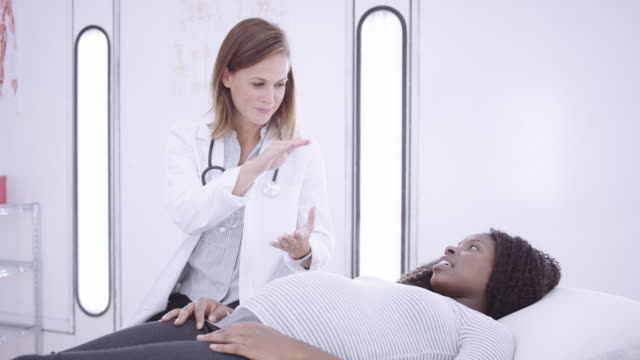 4k uhd: pregnant woman at a medical checkup - gynecological examination stock videos and b-roll footage
