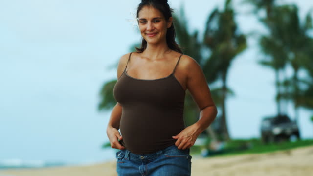 pregnant woman at beach - skirt stock videos & royalty-free footage