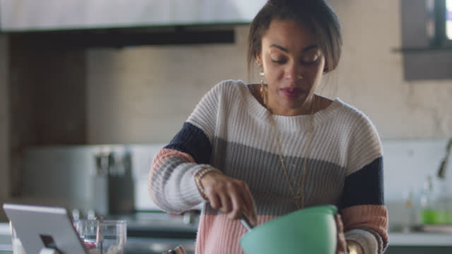 pregnant woman bakes while video calling a loved one - graphical user interface stock videos & royalty-free footage