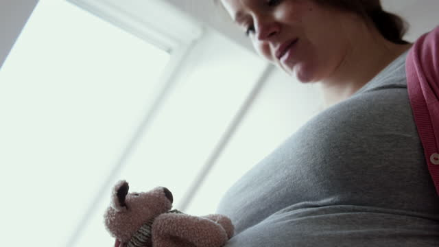 pregnant woman caressing her baby bump. - belly stock videos & royalty-free footage