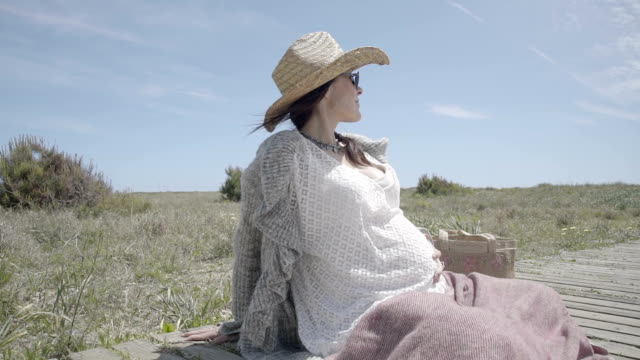 f-m/s pregnant woman caressing her belly (summer) - three quarter length stock videos & royalty-free footage