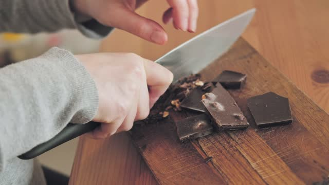 pregnant woman cutting chocolate with nuts - home made stock videos & royalty-free footage