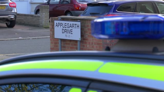 pregnant woman dies after being attacked with crossbow; england: london: ilford: ext road sign 'applegarth drive' and police car in foreground... - ilford stock videos & royalty-free footage