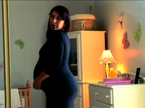 pregnant woman dressing - only mid adult women stock videos & royalty-free footage