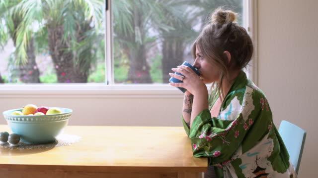 ms pregnant woman drinking tea in the morning - tè raccolto video stock e b–roll