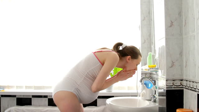 pregnant Woman during morning toilet