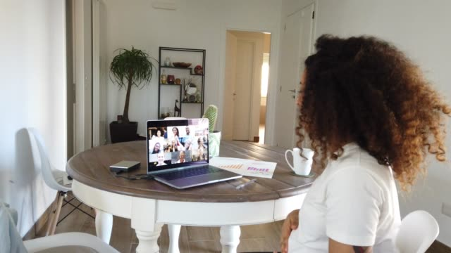 pregnant woman having a work video call with colleagues - pregnant stock videos & royalty-free footage