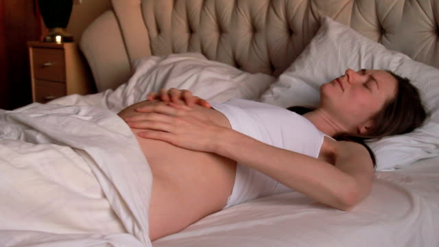 pregnant woman having belly pain - cramp stock videos & royalty-free footage