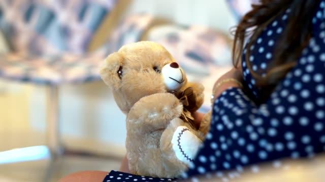 pregnant woman holding teddy bear at home closeup - pardo brazilian stock videos & royalty-free footage