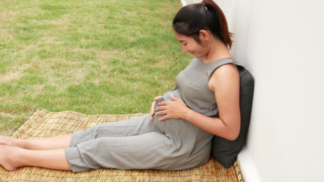 pregnant woman in the park - fetus stock videos and b-roll footage