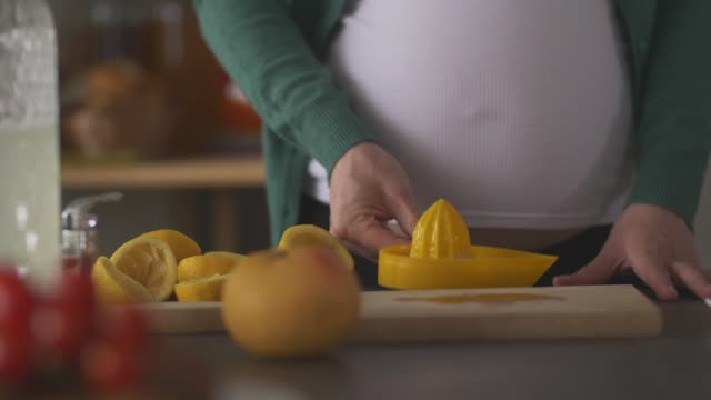 pregnant woman making lemonade to get the vitamin c - vitamin a nutrient stock videos & royalty-free footage