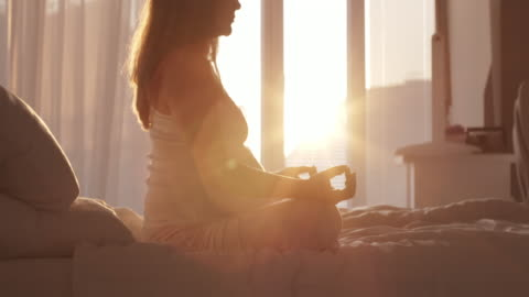 pregnant woman meditating at home - meditating stock videos & royalty-free footage